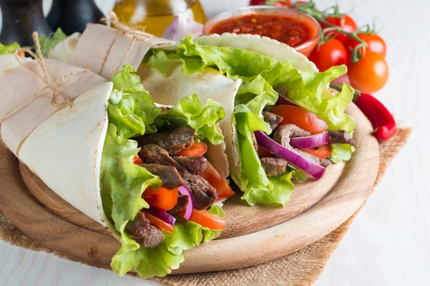 Photo of mexican sandwich or wrap.