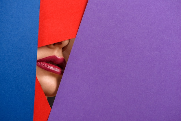 Photo of model's lips surrounded by contrast carton sheets.