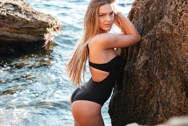 Photo of model in swimsuit. so sexy girl. near the sea