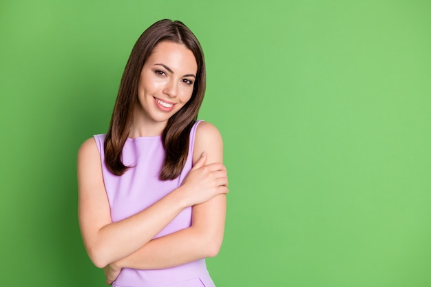 Photo nice adorable young girl lady shiny smile embrace herself look camera posing photographer enjoy atmosphere skin after spa dressed purple outfit isolated pastel green color background