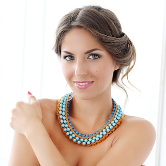 Photo of nice girl wear blue necklace