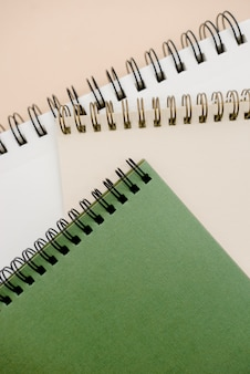 Photo of notepads  on beige background with copy space