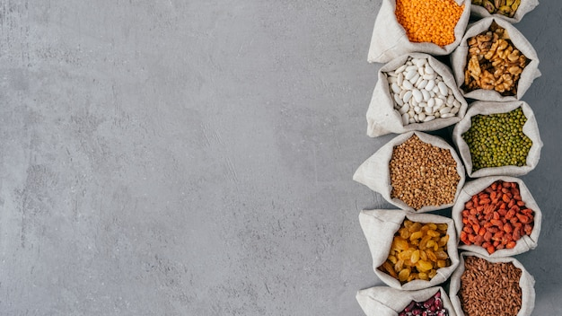 Photo of nutritious organic products in sacks with various beans.
