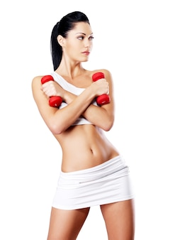 아령과 건강 훈련 젊은 여자의 사진. 건강한 라이프 스타일 개념.