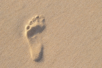 Photo of left human footprint on sand