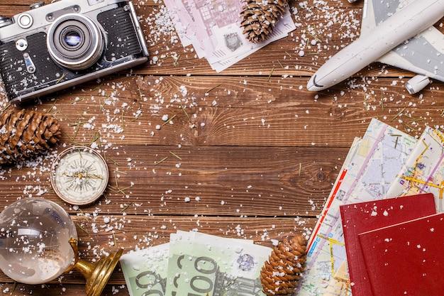 Фотография денег, снега, паспорта, самолета, земного шара на деревянном фоне