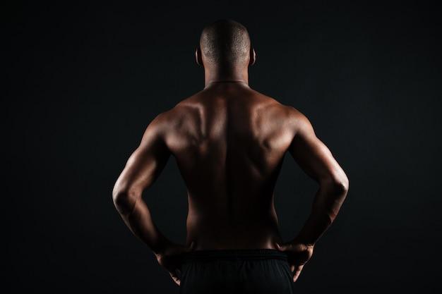 筋肉質のアフロアメリカンスポーツの写真マンバック
