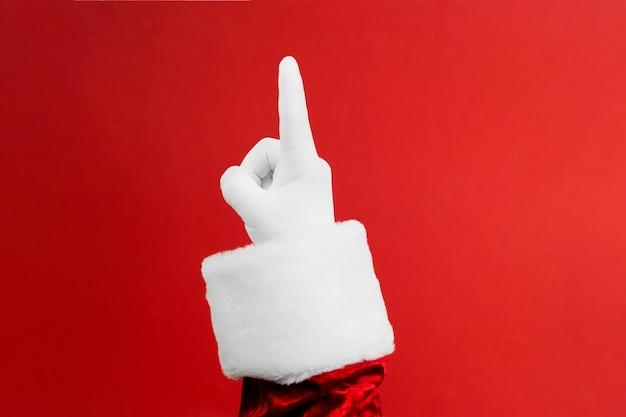 산타 클로스의 사진 장갑을 낀 손 제스처를 가리키는.