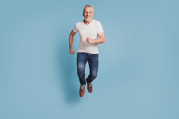Photo of old man jumping up running