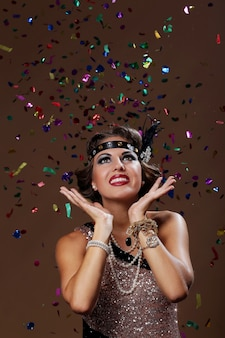 Photo of party woman confetti background in studio