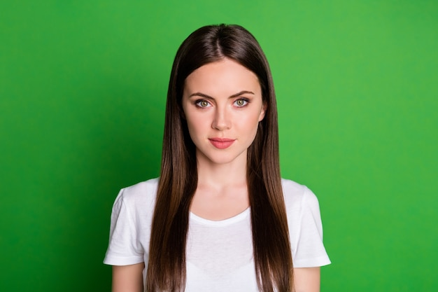 Photo portrait of woman isolated on vivid green colored background