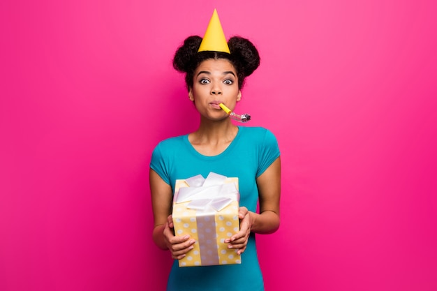 Photo of pretty lady hold big giftbox blowing noisemaker