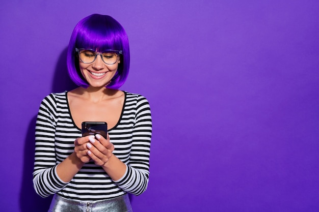Photo of pretty lady holding hands new telephone reading friends letter wear specs striped pullover isolated purple background
