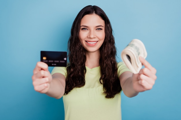 Photo of promoter lady hold credit card currency cash toothy beaming smile on blue background