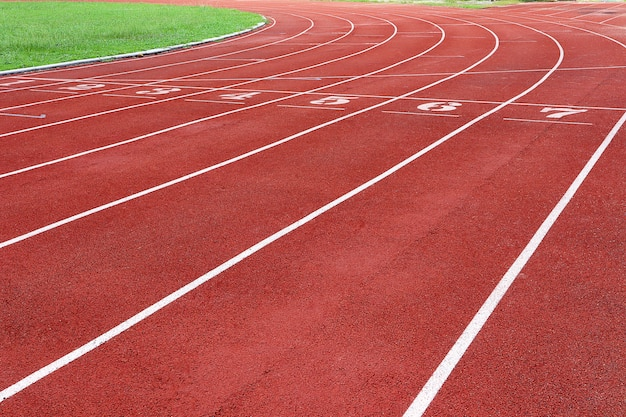Photo of red running track for competition or exercise, as background. sports concept.