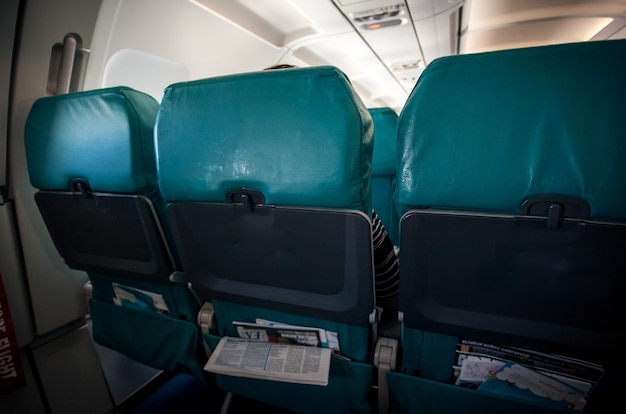Photo of row of airplane seats in low cost aircraft