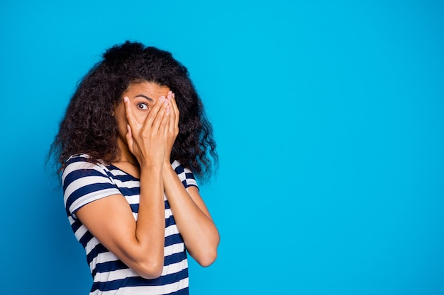 Photo of scared frightful woman hiding her face avoid