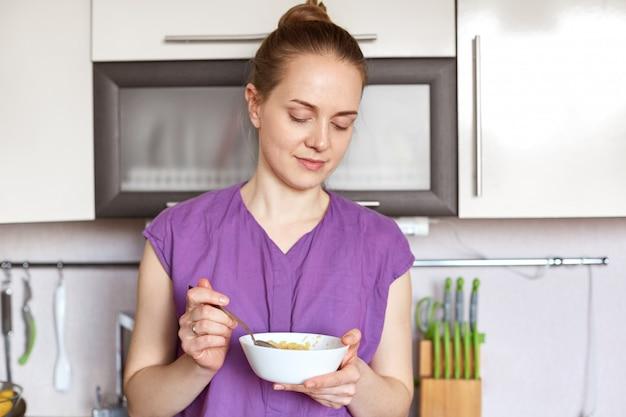 Photo of slim beautiful female model wears purple blouse