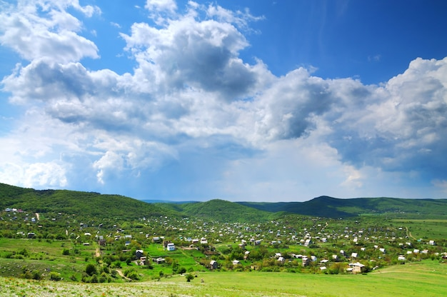 Photo of small village located among mountains.