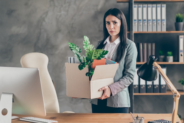 Photo of stressed frustrated depressed girl ceo marketer lose job company bankrupt need search market place hold cardboard box wear jacket blazer in workstation