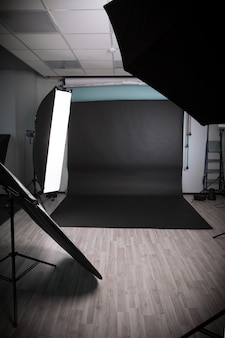 Photo studio with a variety of lighting equipment. photo with copy space