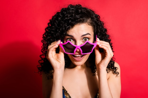 Photo of stunning lady take off glasses open mouth wear star-shaped sunglass isolated bright red color background