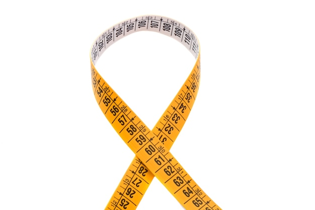Photo of tape measure cross a over white background