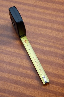 Photo of a tape measure on the desk
