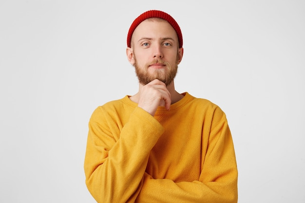 Photo of thoughtful man isolated over white wall