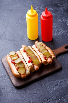 Photo on top of hotdogs on cutting board