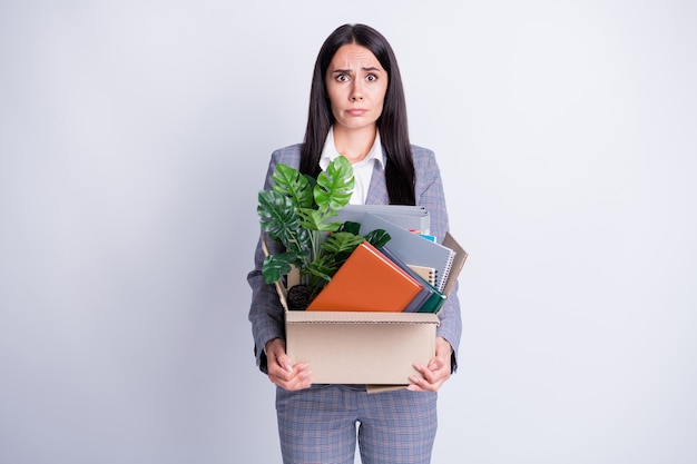 Photo of unhappy desperate crying dismissed lady financial crisis lost work job recession company staff hold carton box belongings stuff quit formalwear isolated grey color background
