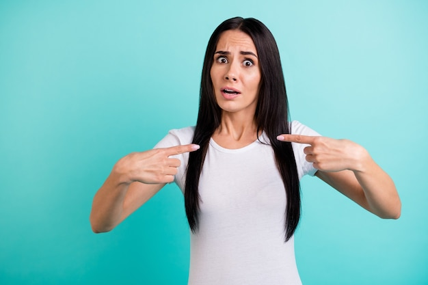 Photo of unhappy sad crazy girlfriend pointing at herself expressing outrageous emotions on face not knowing why she was not chosen isolated vivid color teal background
