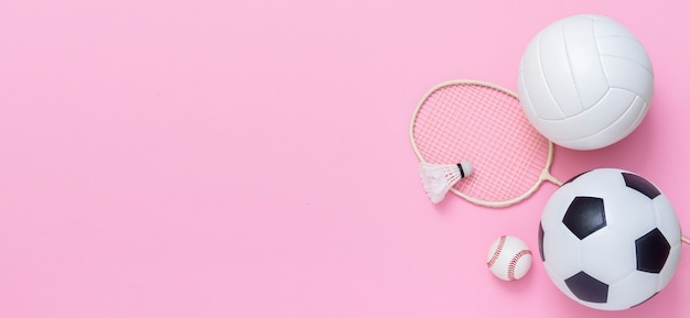 Photo of various sport equipments on pink