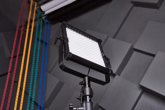 Photo and video led panel on adjustable light stand on grey wall