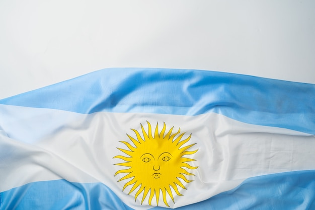 Photo of waving flag of argentina lying on surface close up