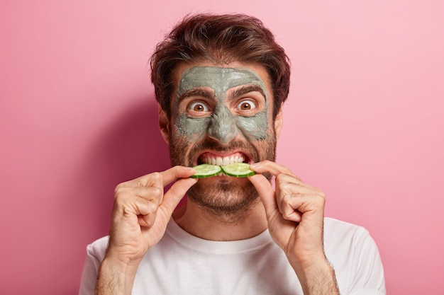 Photo of well kept male doing his beauty routine