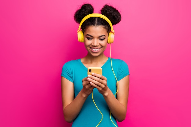 Photo of wondered youngster dark skin lady hold telephone wear headphones