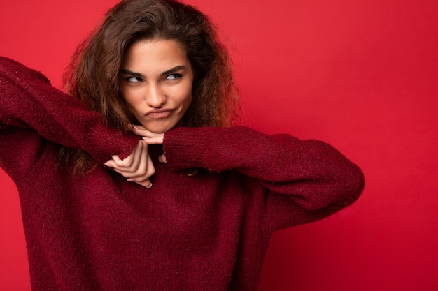 Photo of young funny selfconfident beautiful brunette curly woman with sincere emotions wearing