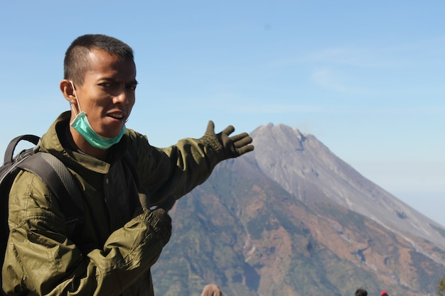 Photo of youth joking with friends on the mountain