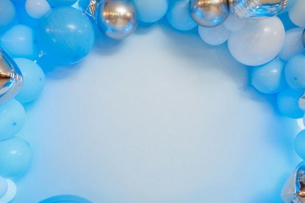 Photo zone with balloons. boy's birthday decor. festive decoration. balloons. childrens party background. festive photo zone in blue.