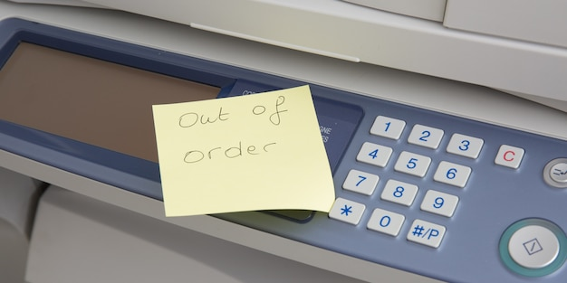 A photocopier with an indication that he is out of order
