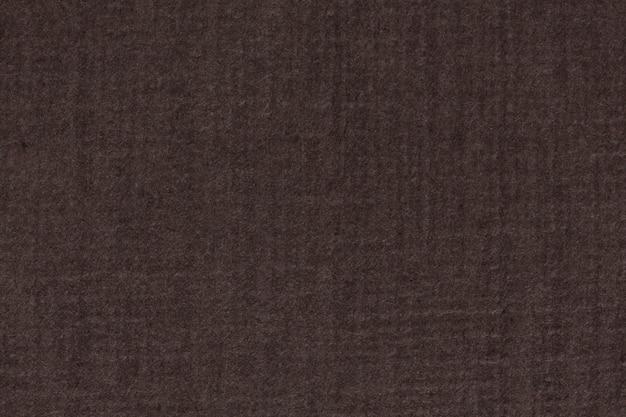 艺术家的粗糙五谷黑褐色淡色纸纹理样品的照片。高分辨率照片。