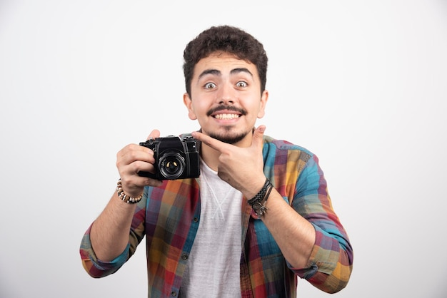 Photograph asking customer to smile as he is taking photos.