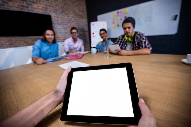 Photograph of a group of coworkers and a tablet computer