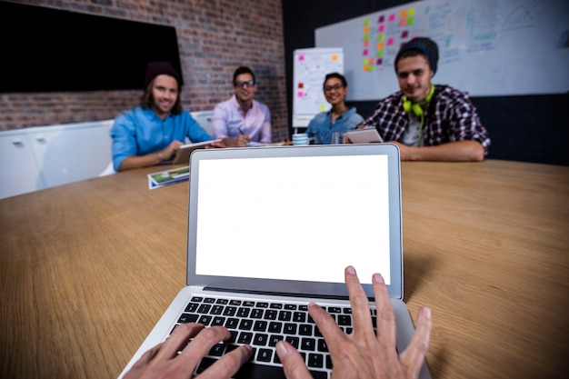 Photograph of a group of coworkers with laptop