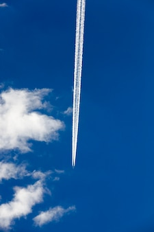 Photographed the aircraft during flight in the blue sky, cloud