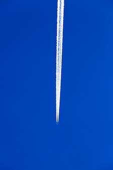 Photographed the aircraft during flight in the blue sky
