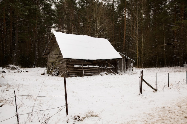 Photographed by a close up old wooden construction. winter