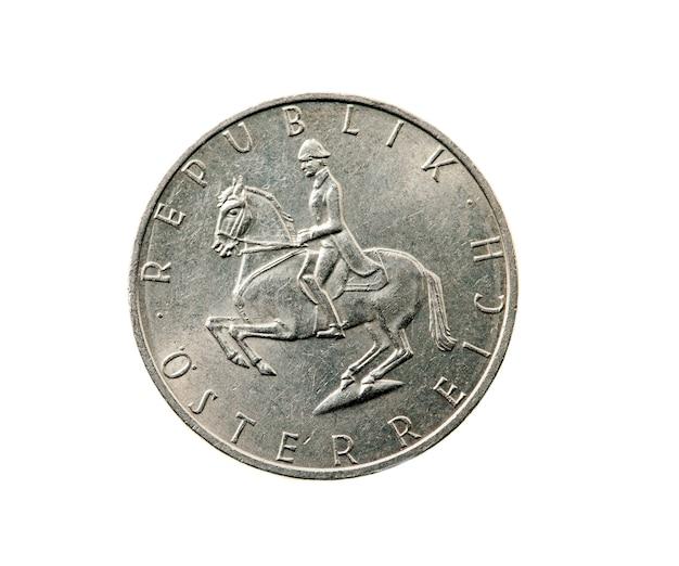 - сфотографировано крупным планом на белой монете, пять шиллингов австрия