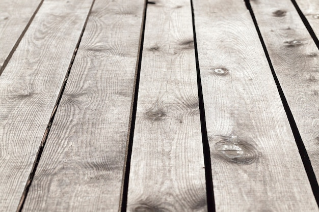 Photographed close-up of the wooden floor of the structure such as a gazebo located outdoors